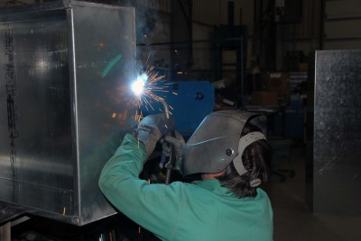 This is a photo of a person welding pieces of metal together